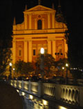 Triple Bridge and Franciscan Church at night
